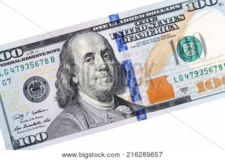 Detail of one hundred dollar bill close-up on white background. High resolution photo.