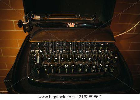 Old vintage typewriter. Typing machine with Russian keys.