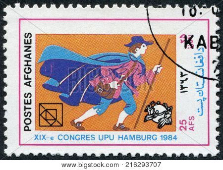 AFGHANISTAN - CIRCA 1984: A stamp printed in the Afghanistan devoted to 19th UPU Congress, Hamburg. Shows a German postman 17th century, circa 1984
