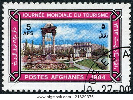 AFGHANISTAN - CIRCA 1984: A stamp printed in the Afghanistan devoted to World Tourism Day. Shows the Victory Monument and Memorial Arch, Kabul, circa 1984