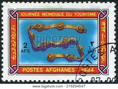 AFGHANISTAN - CIRCA 1984: A stamp printed in the Afghanistan devoted to World Tourism Day. Depicted Ornamental buckled harness, circa 1984