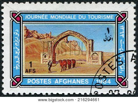 AFGHANISTAN - CIRCA 1984: A stamp printed in the Afghanistan devoted to World Tourism Day. Depicted Qalai Bist Arch, circa 1984