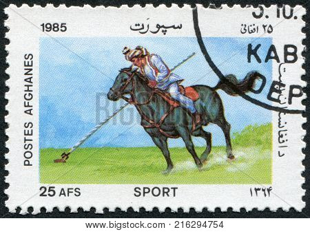 AFGHANISTAN - CIRCA 1985: A stamp printed in the Afghanistan shows Buzkashi, circa 1985