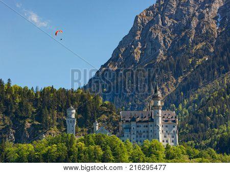 Paraglider above Neuschwanstein Castle, Bavaria, Germany