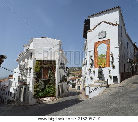 Statue and decorative wall tiles at end of streets  in Alora Adalucia Spain