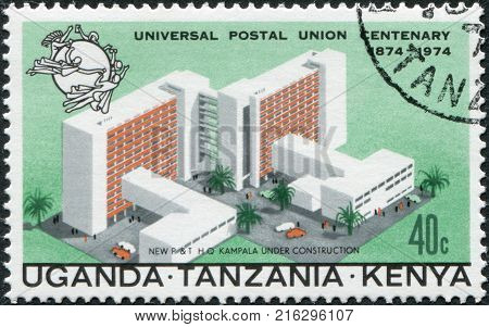 EAST AFRICAN COMMUNITY - CIRCA 1974: A stamp printed in East African Community, is dedicated to the 100th anniversary of the Universal Postal Union, shows a model of the central post office in Kampala, circa 1974
