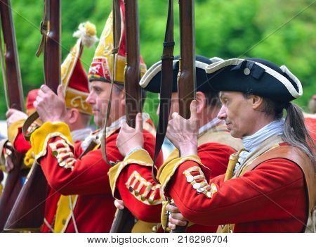 SAFFRON WALDEN, ESSEX, ENGLAND - MAY 01, 2017:  Close up of the  Redcoats of  Pulteneys  Regiment with their Muskets.