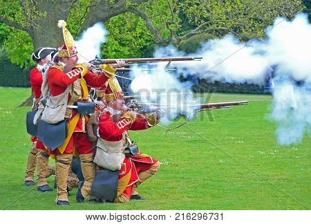 SAFFRON WALDEN, ESSEX, ENGLAND - MAY 01, 2017:  The Redcoats of  Pulteneys  Regiment firing their Muskets.