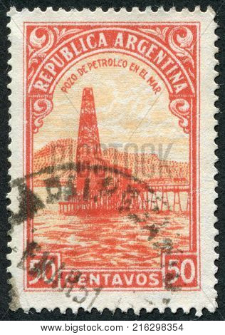 ARGENTINA - CIRCA 1936: A stamp printed in the Argentina, depicts Oil Well, circa 1936