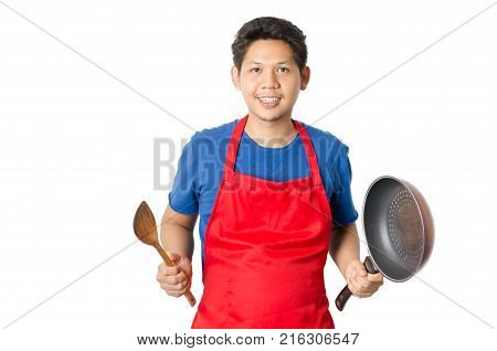 Asian man (Thai man) wear red apron and holding wooden ladle and pan for cooking isolated on white background
