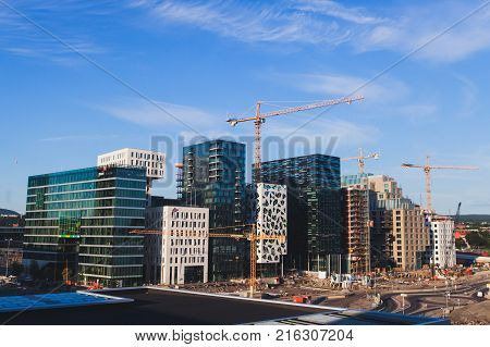 View of Oslo city capital of Norway with Sentrum borough new district and harbour view from Oslo Opera House Eastern Norway poster