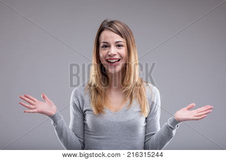 Smiling Woman Showing Open Hands