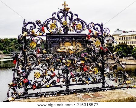 Locks cover a monument on the St. Charles Bridge in Prague.