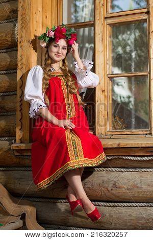Russia, Moscow, Izmaylovsky Park, August 27, 2017. International Photo Festival.Beautiful woman portrait in russian style. Beautiful Russian girl in traditional dress. Russian style.