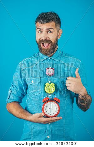 Time and perfect morning. Overtime and urgency. Time management and countdown. Lifetime business and deadline. happy man with beard hold alarm clock show thumb up gesture watchmaker