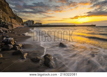 romantic multi-colored sunset in Tenerife Los Gigantes cliffs