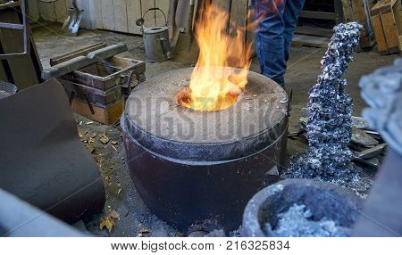 Small fire rising  up  in concrete oven