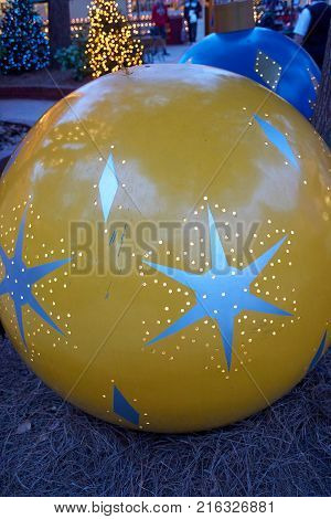 Large round yellow  holiday decoration outside with star