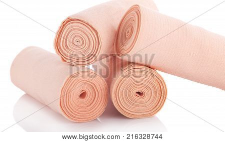 Medical bandage rolls bandage elastic scotch tape first aid supplies a white background.