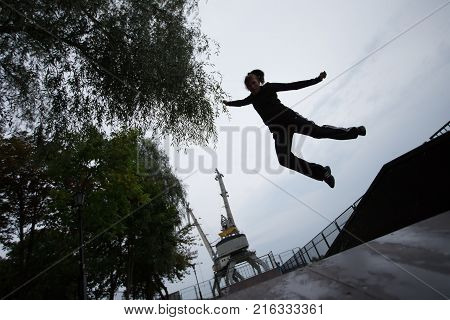 Belarus, Gomel, Central Park, September 04, 2017, sports ground. A teenager is jumping up. Leap up.