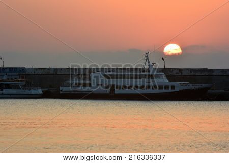 YALTA CRIMEA SEPTEMBER 18 2017: Sunrise over the port of Yalta