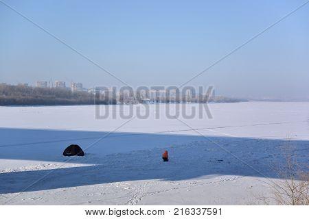 Winter ice fishing on the river Irtysh Omsk Siberian region Russia
