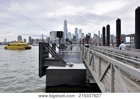 JERSEY CITY USA - AUG. 23 : View of Manhattan from Paulus Hook on August 23 2017 in Jersey City NJ. Manhattan is the most densely populated borough of New York City.
