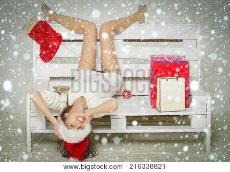 Santa Claus Girl With Gift On Bench.