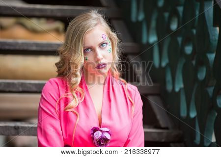 Russia Moscow Izmaylovsky Park August 27 2017. International Photo Festival.A girl with a crazy face. Crazy Blonde