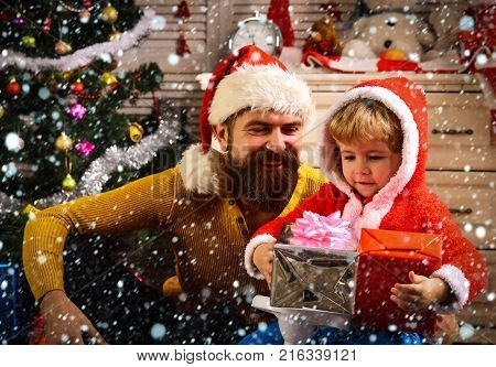 Christmas Happy Child And Father With Present Box.