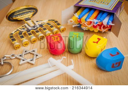 The Jewish Hanukkah holiday concept stock image. Hebrew letters on dreidel teetotum say