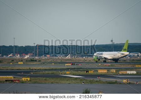 FRANKFURT AM MAIN GERMANY - JULY 19 2017: Boeing 737 YL-CSB of Air Baltic airlines stay on runway before departure from Frankfurt am Main airport