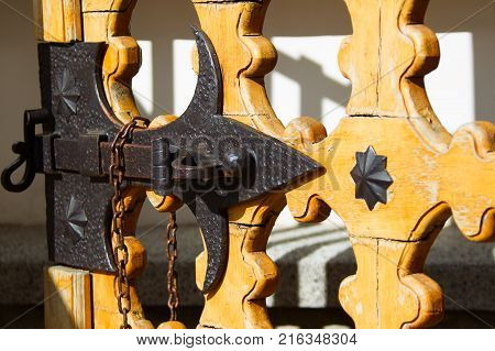 An old bolt. An ancient castle from the door. Retro key. The door bolt is iron historical