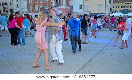 ROVINJ, ISTRIA, CROATIA - JUNE 26, 2017: Salsa Dancing in the town square Rovinj Croatia