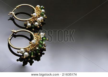 Handmade Earrings With Gemstones Over Black Background