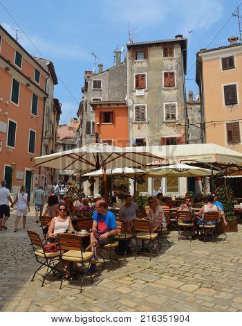 ROVINJ, ISTRIA, CROATIA - JUNE 18, 2017: Diners at tables in a restaurant  in the old town of Rovinj  Croatia
