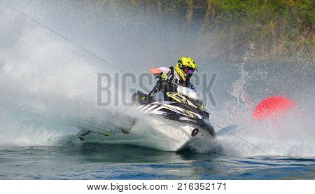 WYBOSTON, BEDFORDSHIRE, ENGLAND -  APRIL 09, 2017: Jet Ski competitor cornering at speed creating at lot of spray.