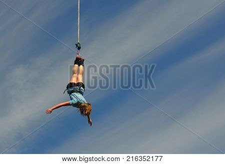WYBOSTON, BEDFORDSHIRE, ENGLAND - JULY 08, 2017   Girl Bungee jumper on end of rope.