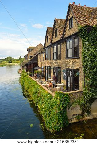 ST IVES, CAMBRIDGESHIRE, ENGLAND - JULY 22, 2017: The River Tearooms on the banks of the River Ouse at St Ives Cambridgeshire.