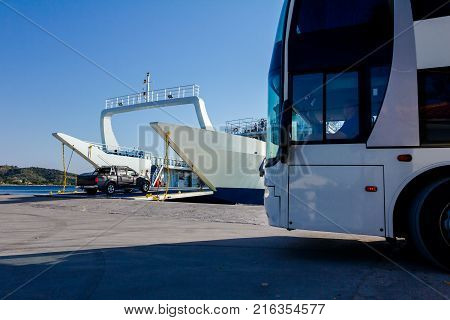 Large ferryboat has opened his front gate for boarding busses and other vehicles at the local port.