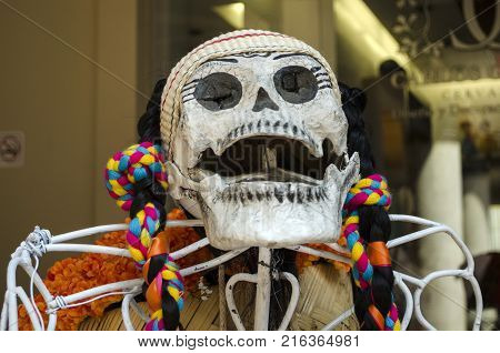 OAXACA, OAXACA, MEXICO- OCTOBER 30, 2017: Skull dressed with traditional clothes as decoration for mexican Day of the Dead celebration in Oaxaca, Mexico