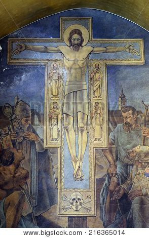 ZAGREB, CROATIA - AUGUST 19: Christ is crucified with evangelists, fresco in the church of St. Mark in Zagreb, Croatia on August 19, 2017.