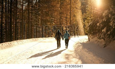 A Couple walking on the snow in Morskie Oko Poland