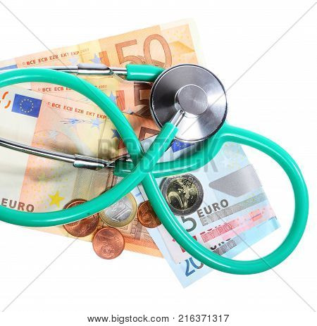 medical treatment and high cost for a good health care service concept: green stethoscope on money euro paper banknotes isolated