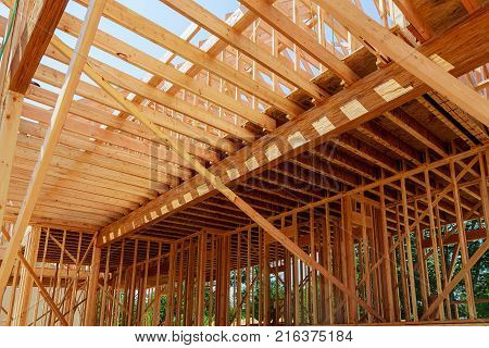 New Home Construction. Build With Wooden Truss, Post And Beam Framework.