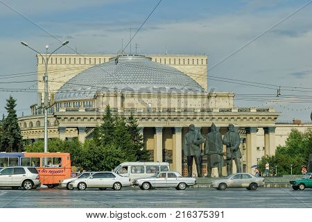Novosibirsk Russia - July 26 2005: Road traffic and famous opera and ballet theater