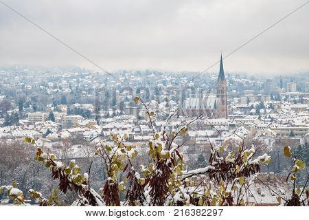 View from Schlossberg in Graz to Herz-Jesu-Church with some snow in winter