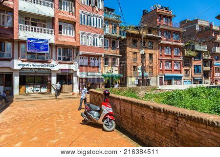 BHAKTAPUR NEPAL - September 24 2013: Street in Bhaktapur ancient Newar city in the Kathmandu Valley. Bhaktapur has the best preserved palace courtyards and old city center in Nepal.