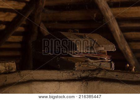 old chest in the attic. Suitcase retro in web