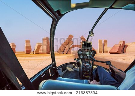 Helicopter cockpit with pilot arm and control console inside the cabin on the Allah Door, entrance of Ras Mohammed National Park. Sharm el Sheikh, Sinai Peninsula, Egypt.